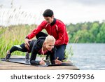 woman with personal trainer... | Shutterstock . vector #297509936