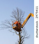 men in a crane cutting down a... | Shutterstock . vector #2975411