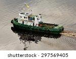 A Tug Boat Pulling A Pontoon On ...