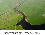 A Green Rice Field With Canal...