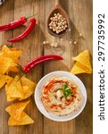 hummus with nachos and chilli... | Shutterstock . vector #297735992