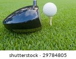 golf ball on tee with driver - stock photo