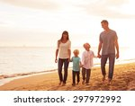 happy young family on the beach ... | Shutterstock . vector #297972992