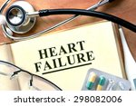 Small photo of Heart failure concept. Books with stethoscope and.