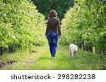 woman strolling with her dog in ... | Shutterstock . vector #298282238