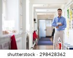 a happy male teacher dressed... | Shutterstock . vector #298428362