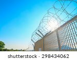 metal fence with barbwire under ... | Shutterstock . vector #298434062