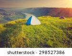 Tourist Tent On Green Meadow A...