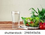 vegetable salad with a glass of ...