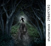 Stock photo horror monster walking in a dark forest as a scary fantasy concept with a creepy zombie coming out 298697192