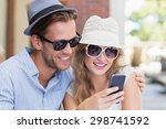 cute couple looking at their... | Shutterstock . vector #298741592