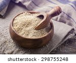 Stock photo white quinoa seeds on a wooden background 298755248