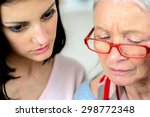 helping old woman use a tablet... | Shutterstock . vector #298772348