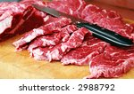 fresh beef on wooden board with knife - stock photo