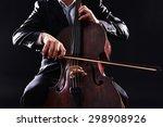 man playing on cello on dark... | Shutterstock . vector #298908926