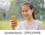 happy girl looking at a mobile... | Shutterstock . vector #299119448