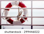 lifebuoy on the railing of the...