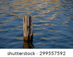 A Single Wooden Piling At...