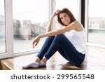 beautiful girl in blue jeans... | Shutterstock . vector #299565548