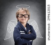 Small photo of School boy angel with wings and halo concept for being clever, good, success in education or smug