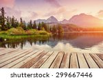 Stock photo the sunrise over a lake in the park high tatras shtrbske pleso slovakia europe 299667446