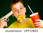 boy with meal in a mouth - stock photo