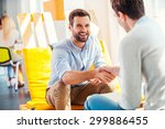 sealing a deal  two happy young ... | Shutterstock . vector #299886455
