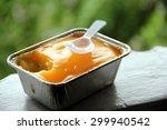 Small photo of Fresh Orange cake in aluminian box, dessert concept.