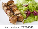 two chicken and beef kebab with salad and lemon - stock photo