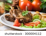 pork spareribs served with... | Shutterstock . vector #300004112