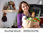 young woman holding grocery... | Shutterstock . vector #300024296