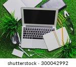workspace on grass. | Shutterstock . vector #300042992