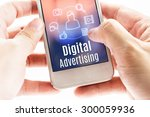 Small photo of Close up hand holding mobile with Digital Advertising and icons, Digital Marketing concept.