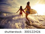 two ladies running into the sea ... | Shutterstock . vector #300122426