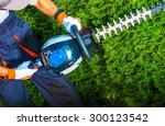 trimming time. gardener with... | Shutterstock . vector #300123542