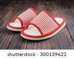 slipper on wooden background  ... | Shutterstock . vector #300139622