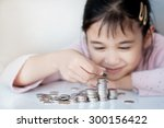 little girl and pile coin for... | Shutterstock . vector #300156422