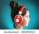 beautiful little girl listening ... | Shutterstock . vector #300392012