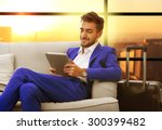 Small photo of Business man with suitcase in hall of airport