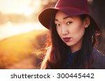 asian woman outdoors | Shutterstock . vector #300445442