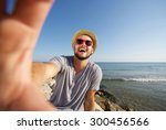 happy man on vacation laughing... | Shutterstock . vector #300456566