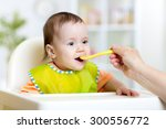 kid girl eating with spoon... | Shutterstock . vector #300556772