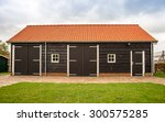 A Tiled Roof Wooden Outhouse...