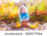 Girl Holding Acorn And Colorfu...