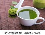 green tea matcha in a white cup ... | Shutterstock . vector #300587606
