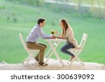happy couple talking at table | Shutterstock . vector #300639092