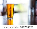 pint glass of india pale ale on ... | Shutterstock . vector #300703898