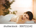 young woman lying on massage... | Shutterstock . vector #300721142