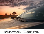 suv in a wheat field sunset | Shutterstock . vector #300841982