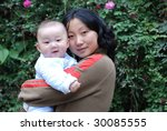 cute baby boy smile with his mother - stock photo